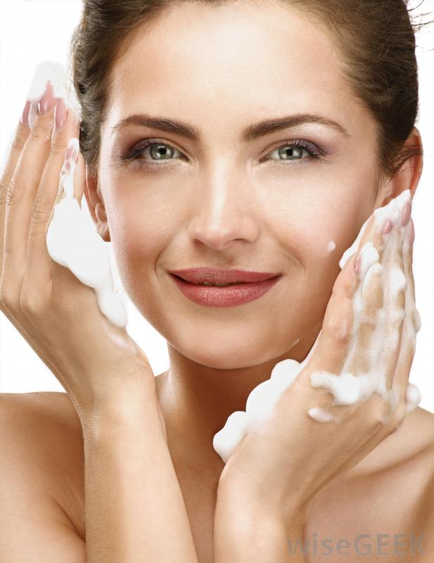 woman-applying-face-wash-to-facial-skin