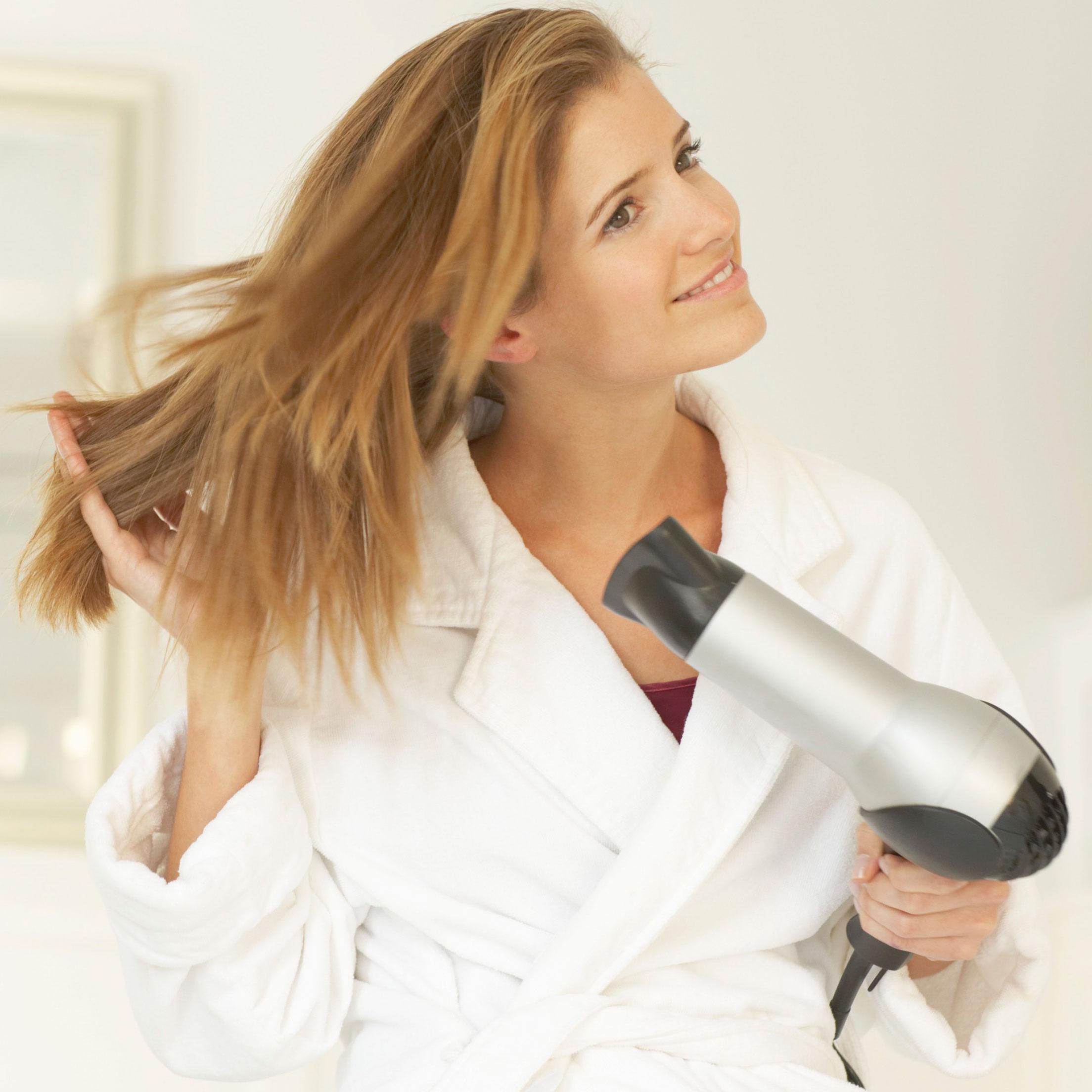 woman-blowdrying-hair-700