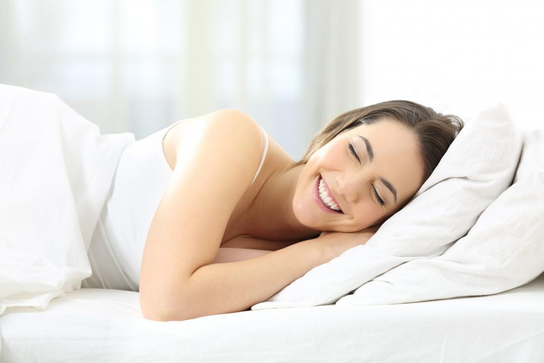 woman-laughing-in-sleep